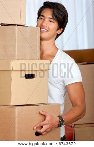 Man Carrying Carton Boxes