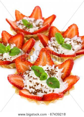 Tasty tartlet with strawberries close-up