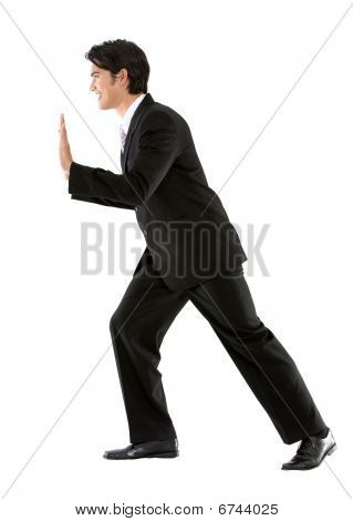 Business Man Pushing A Wall