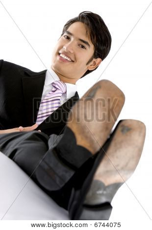 Business Man With Feet On The Table