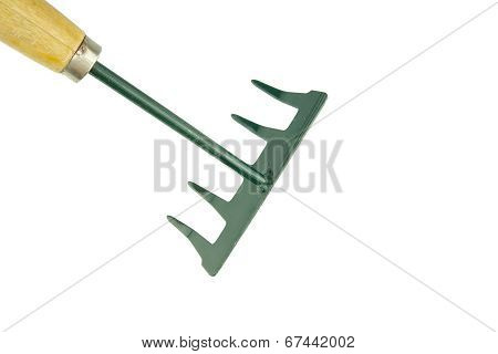 Small Green Harrow With Wooden Handle Placed Top Left Isolated