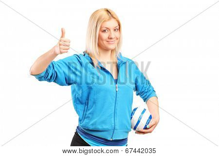 Professional female handball player giving thumb up isolated on white background