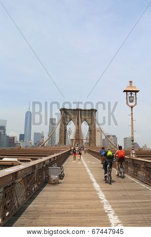 Pedestrians and bicyclists crossing Brooklyn Bridge