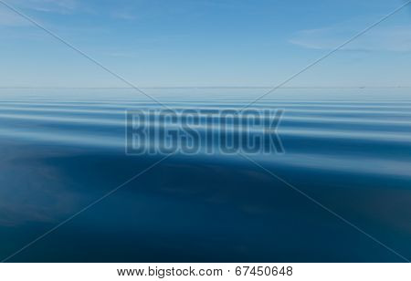 Calm blue Arctic Ocean with faint ripples