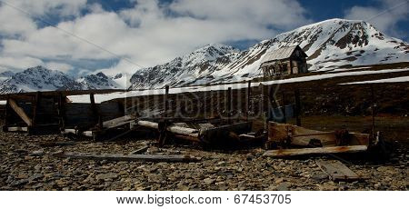 Rickety hut behind rusty old mining equipment