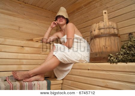 Young Woman Is Sitting At Sauna Bath