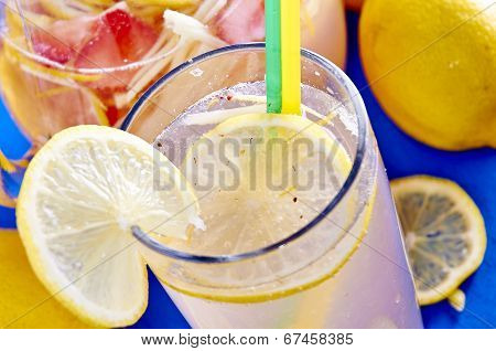 Ice cold lemonade in a glass with pithcer