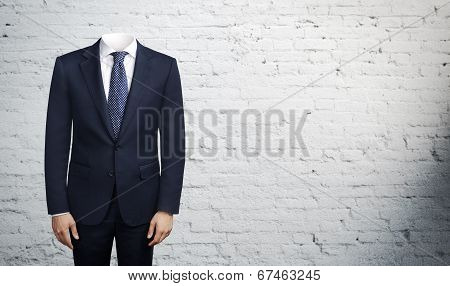 man in suit without head
