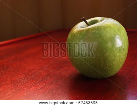 Green Apple on a Red Table