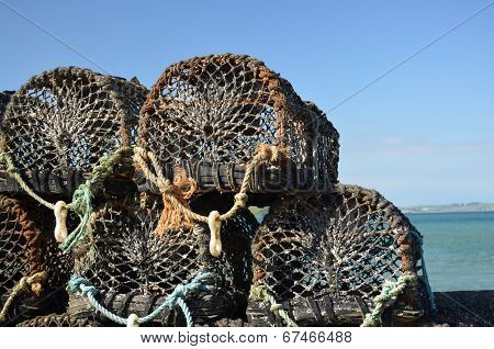 Fishing lobster pots.