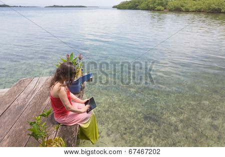Woman working on the digital tablet