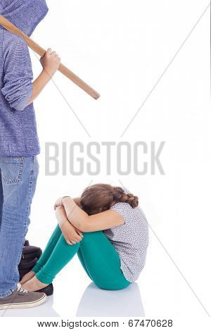 Boy holding a wooden stick to beaten on a little girl, isolated on a white background