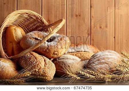Whole grain wheat bread in basket with wheat ears.