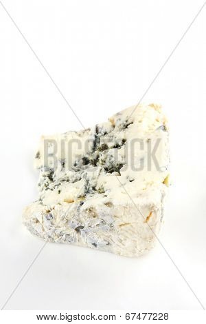soft moldy roquefort cheese on white dish