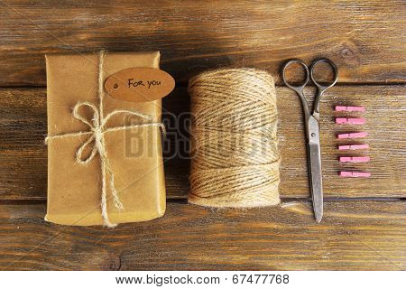 Natural style handcrafted gift box on wooden background. Concept of natural style design