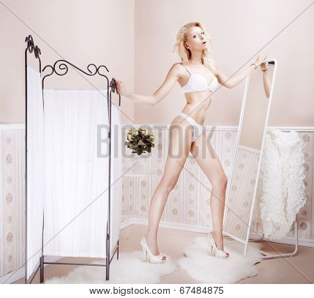 Sexy Blonde Woman In Lingerie Posing.