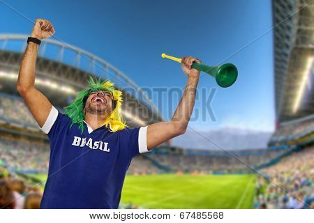 Brazilian fan with wig and stadium horn celebrating at stadium