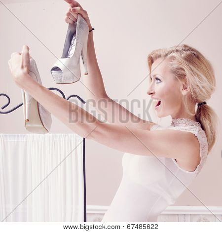 Smiling Woman Looking At Shoes