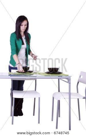 Beautiful Teenager Preparing The Table