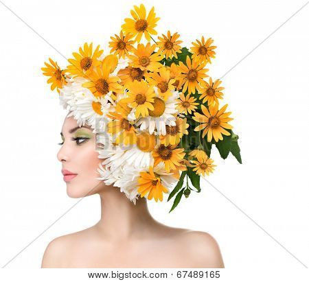 Beauty Girl with Daisy Flowers Hair Style. Beautiful Model woman with Blooming chamomile flowers on her head. Nature Hairstyle. Summer. Holiday Creative Makeup. Fashion Make up. Vogue Style Portrait