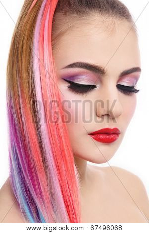 Portrait of young beautiful girl with colorful ponytail over white background