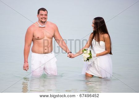 Newlyweds On Their Wedding Day At Sea