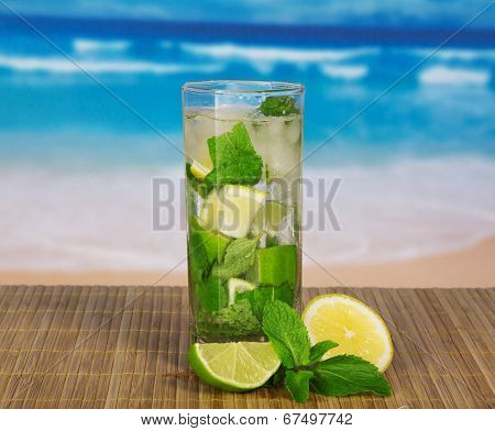 Glass with mojito, juicy lime and a spearmint