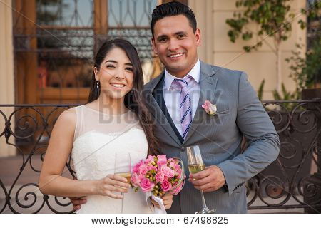 Newlyweds Toasting With Champagne