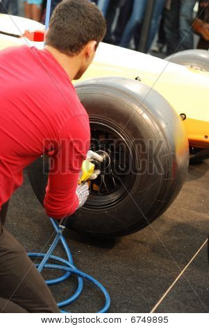 Ambitious Man Changing His F1 Car Wheel