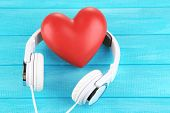 foto of heart sounds  - Headphones and heart on color wooden background - JPG