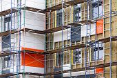 stock photo of scaffold  - Apartment construction in the process of being built with scaffolding - JPG