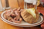 picture of pot roast  - turkey pot roast with a baked potato and butter - JPG