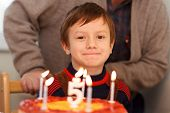 picture of grandpa  - Little kid celebrate birthday with grandpa at home - JPG
