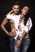 pic of hot couple  - fashion photo of sexy beautiful couple wearing jeans - JPG