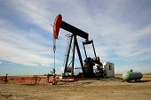 stock photo of nonrenewable  - An oil pump jack in Southern Alberta - JPG