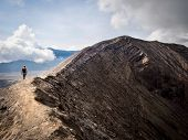 image of gunung  - Hiker walking around the rim of Gunung Bromo volcano in East Java - JPG