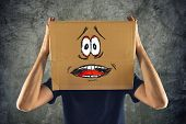 picture of terrifying  - Man with cardboard box on his head and terrified look skethed - JPG