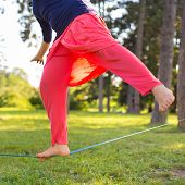 foto of nylons  - Slacklining is a practice in balance that typically uses nylon or polyester webbing tensioned between two anchor points - JPG