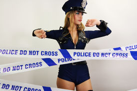 image of strip tease  - beautiful young women dancing and posing dressed as a sexy police officer - JPG