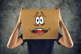 stock photo of horrifying  - Man with cardboard box on his head and terrified look skethed - JPG