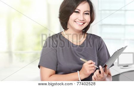 Middle Aged Business Woman Holding A Clipboard
