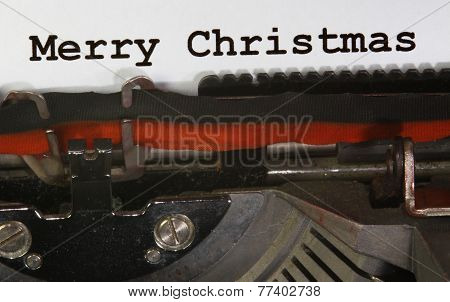 Old Typewriter Types Merry Christmas  Closeup With Black Ink