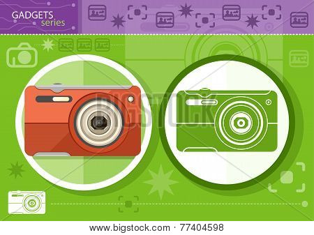 Digital camera in frame on green background