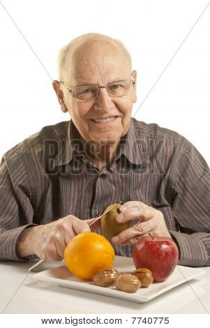 Senior Man Eating Fresh Fruit