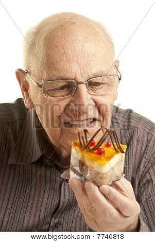 Senior Man Eating A Cake