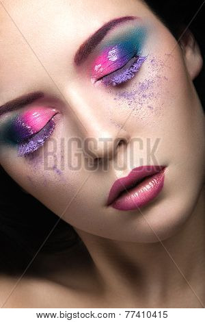 Beautiful girl with bright pink make-up and perfect skin. Beauty face. Festive image.
