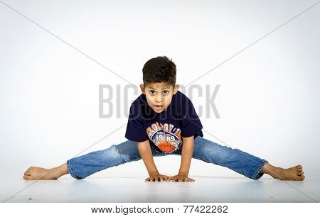 Young Active Afro-american Boy Doing Gymnastics