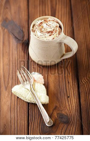 grated chocolate with hot chocolat vintage mug, topping with cream , shallow dof