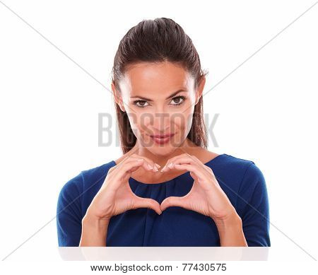 Charming And Sexy Female Making A Love Sign