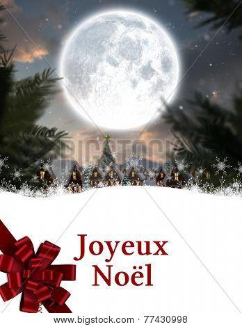 Joyeux noel against christmas village under full moon